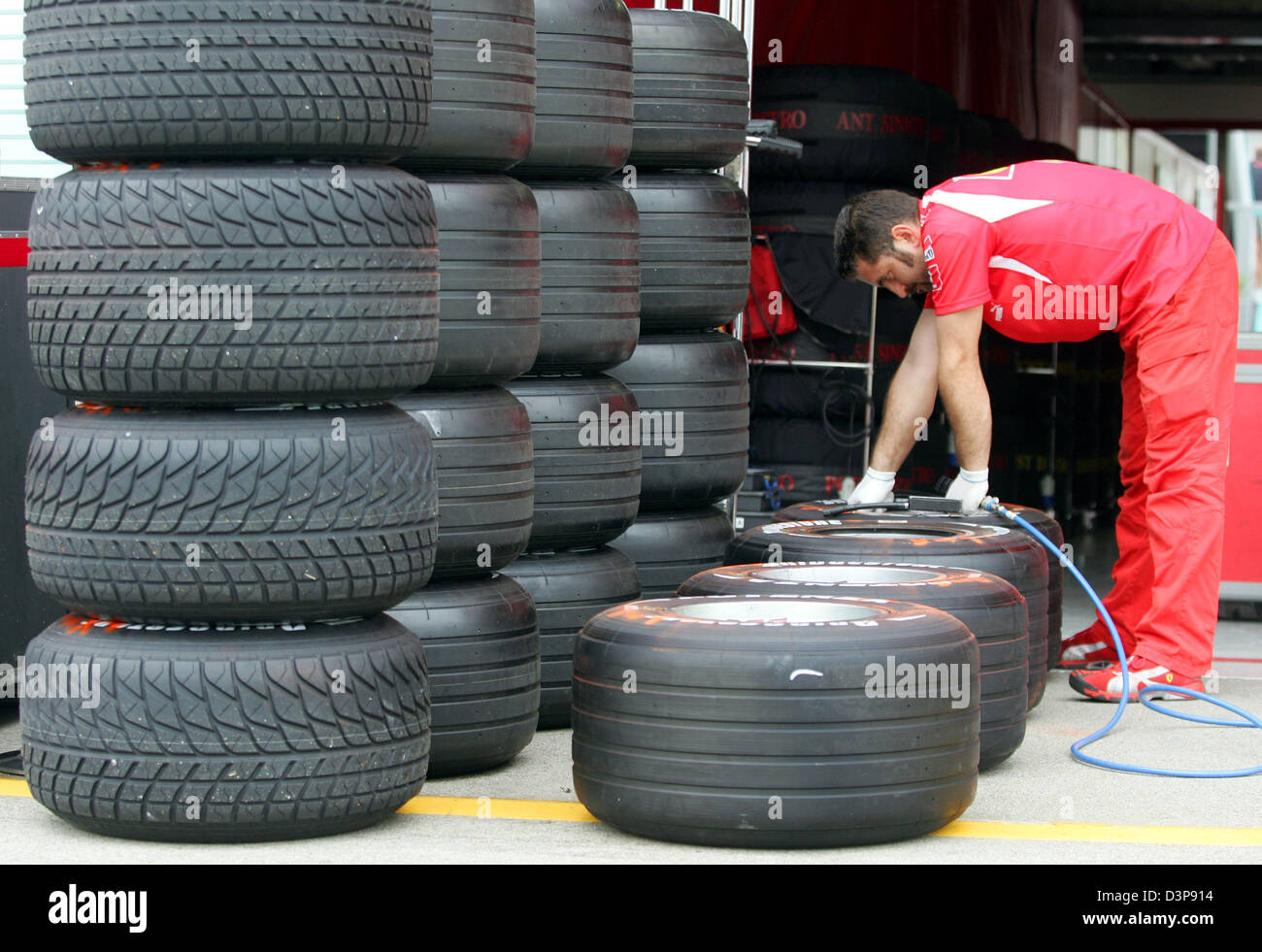 A mechanic of Scuderia Ferrari F1 Team works on Bridgestone