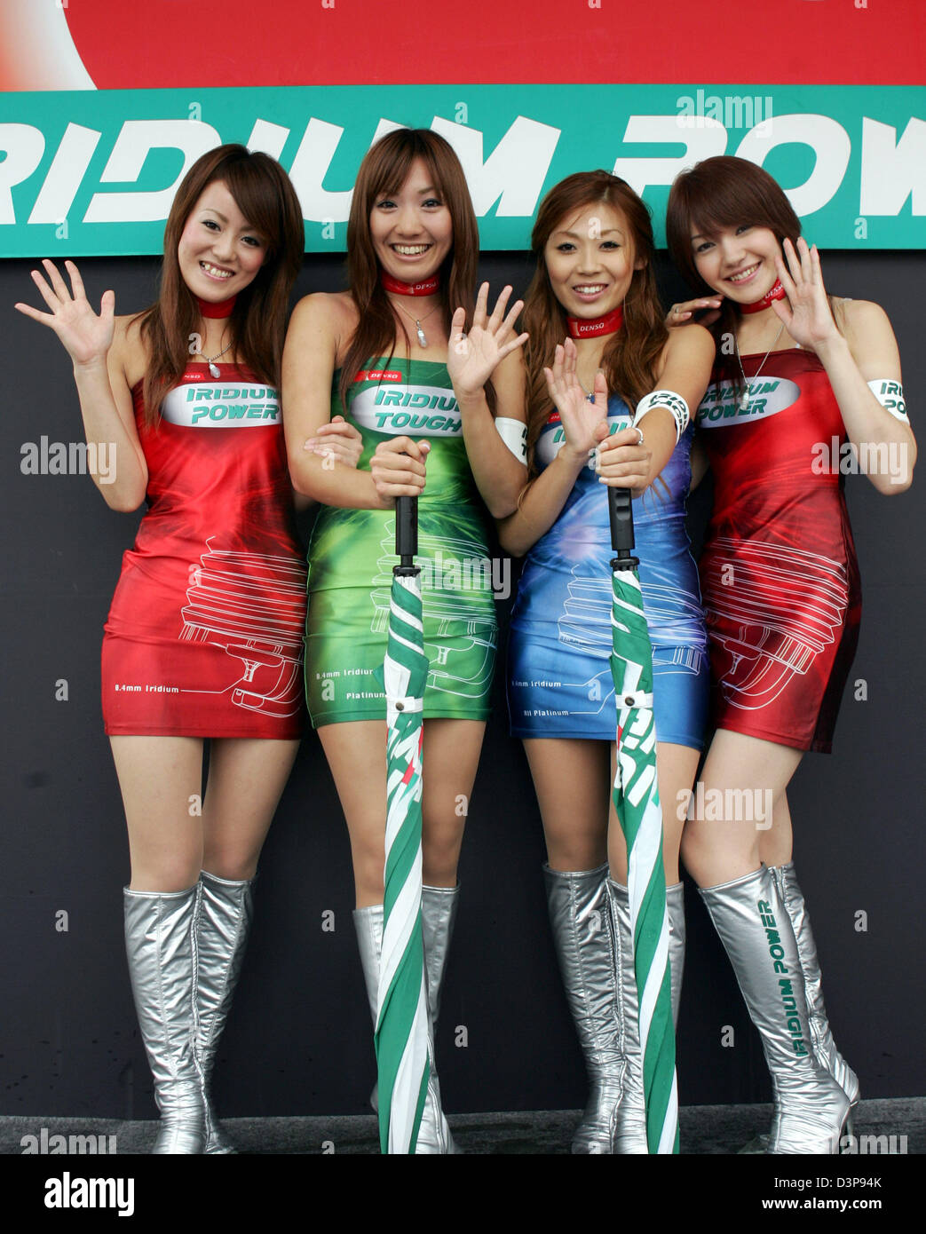 Girls wave to the camera at the Suzuka International Racing Course in Suzuka, Japan, Friday, 06 October 2006. The 2006 Formula 1 Japanese Grand Prix will take place here on Sunday, 08  October. Photo: Gero Breloer Stock Photo