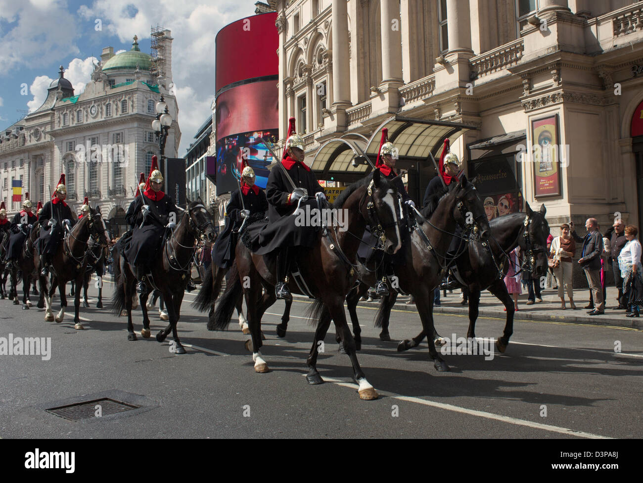 The Horse Guard Cavalry parading through Piccadilly Circus, London, England - Stock Image