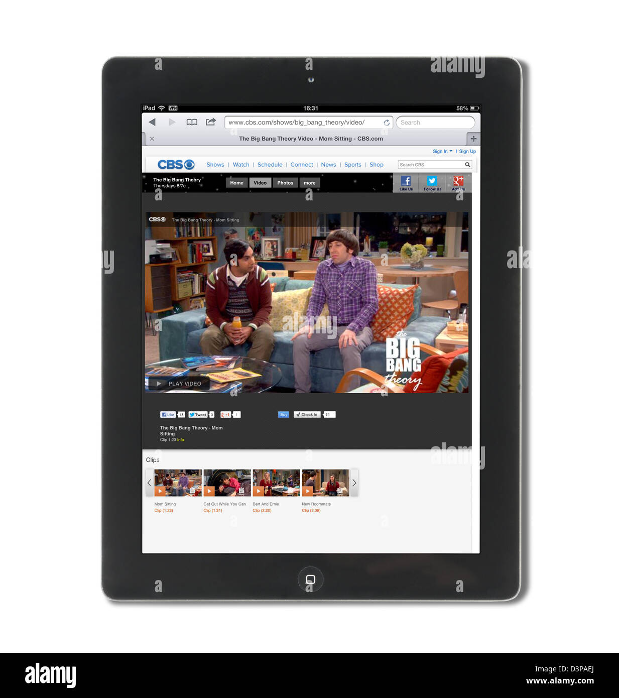 Watching a clip from the hit comedy The Big Bang Theory on the CBS website via an iPad tablet, USA - Stock Image