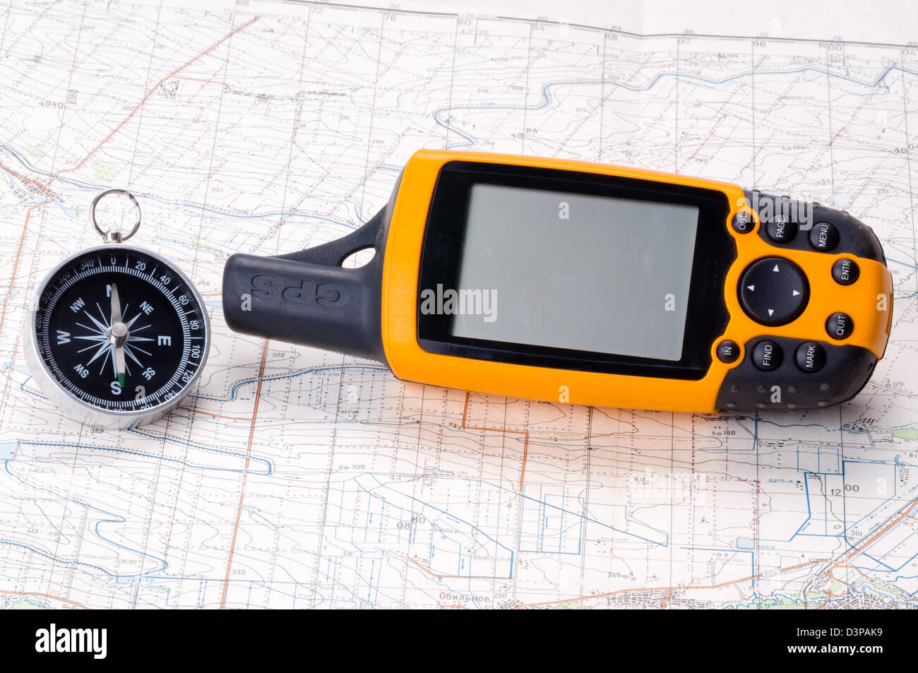 Compass and gps navigator on the map - Stock Image