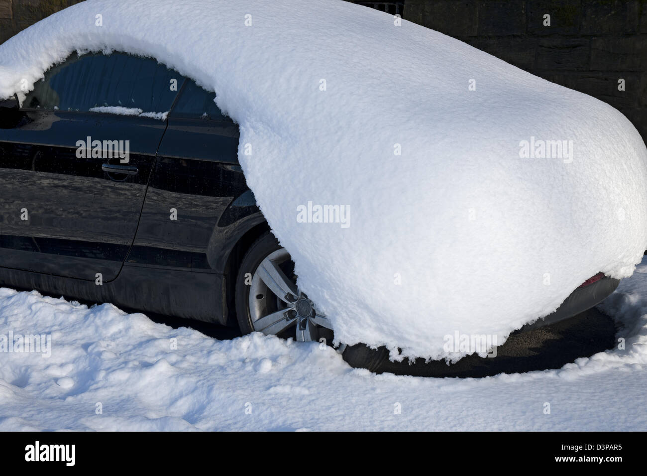 Parked car covered in a blanket of snow York North Yorkshire England UK United Kingdom GB Great Britain - Stock Image