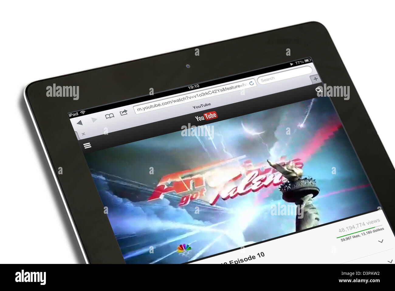 Watching a streaming video of America's Got Talent on YouTube on an iPad - Stock Image