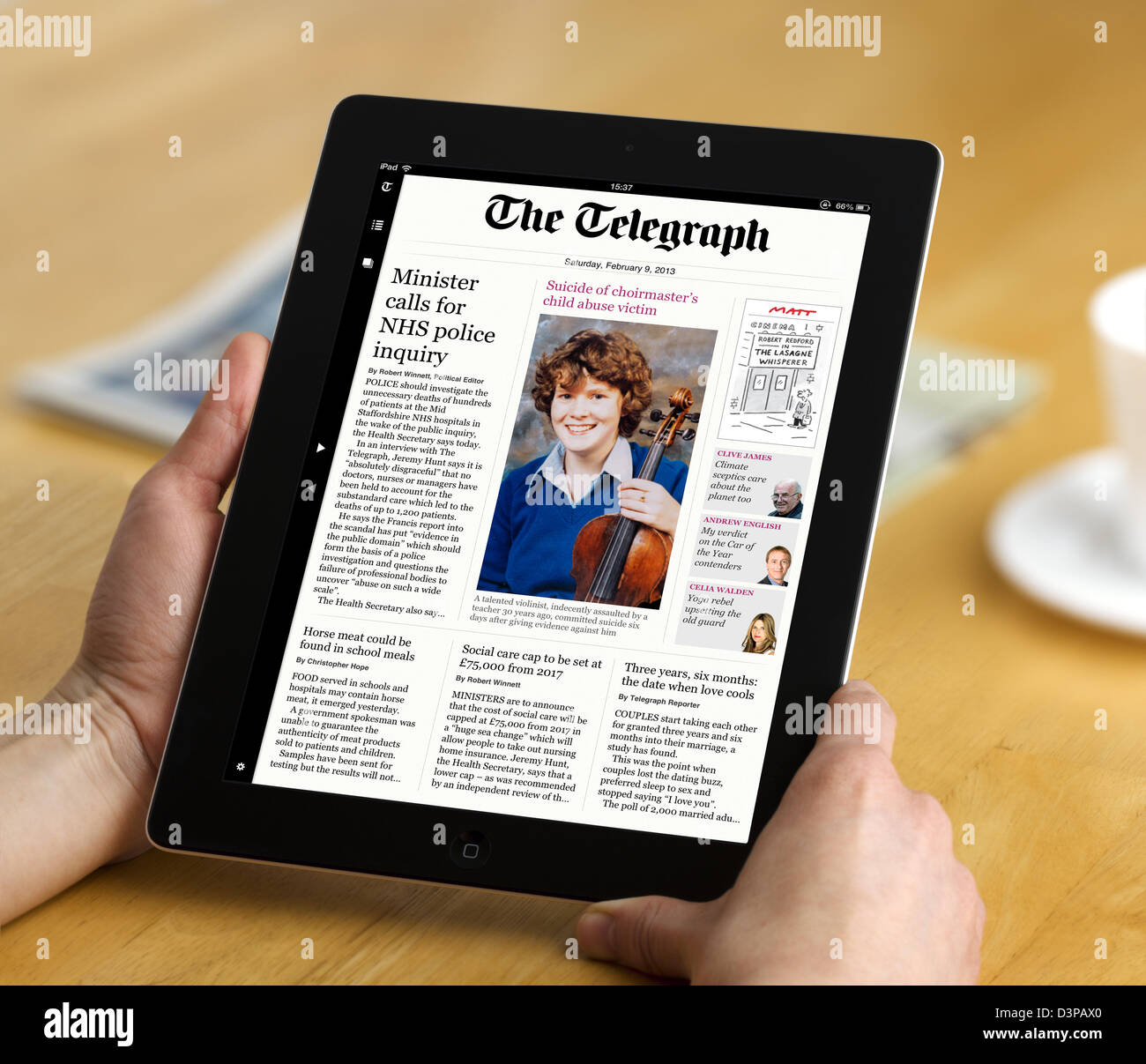 Reading the app edition of the Daily Telegraph newspaper on a 4th Generation iPad, UK - Stock Image