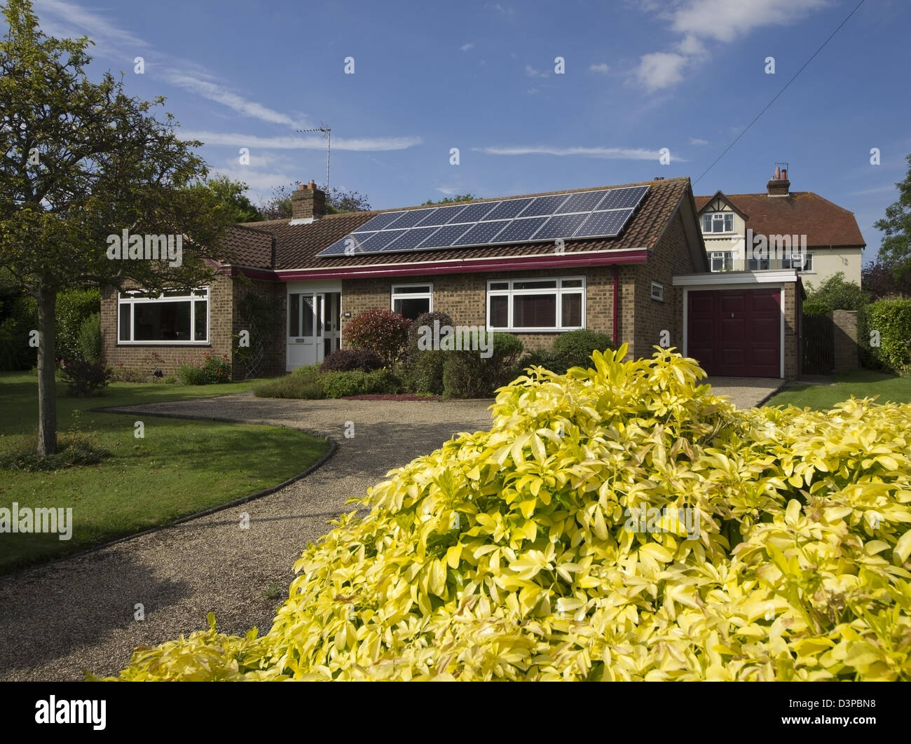 array of 16 solar panels on bungalow - Stock Image
