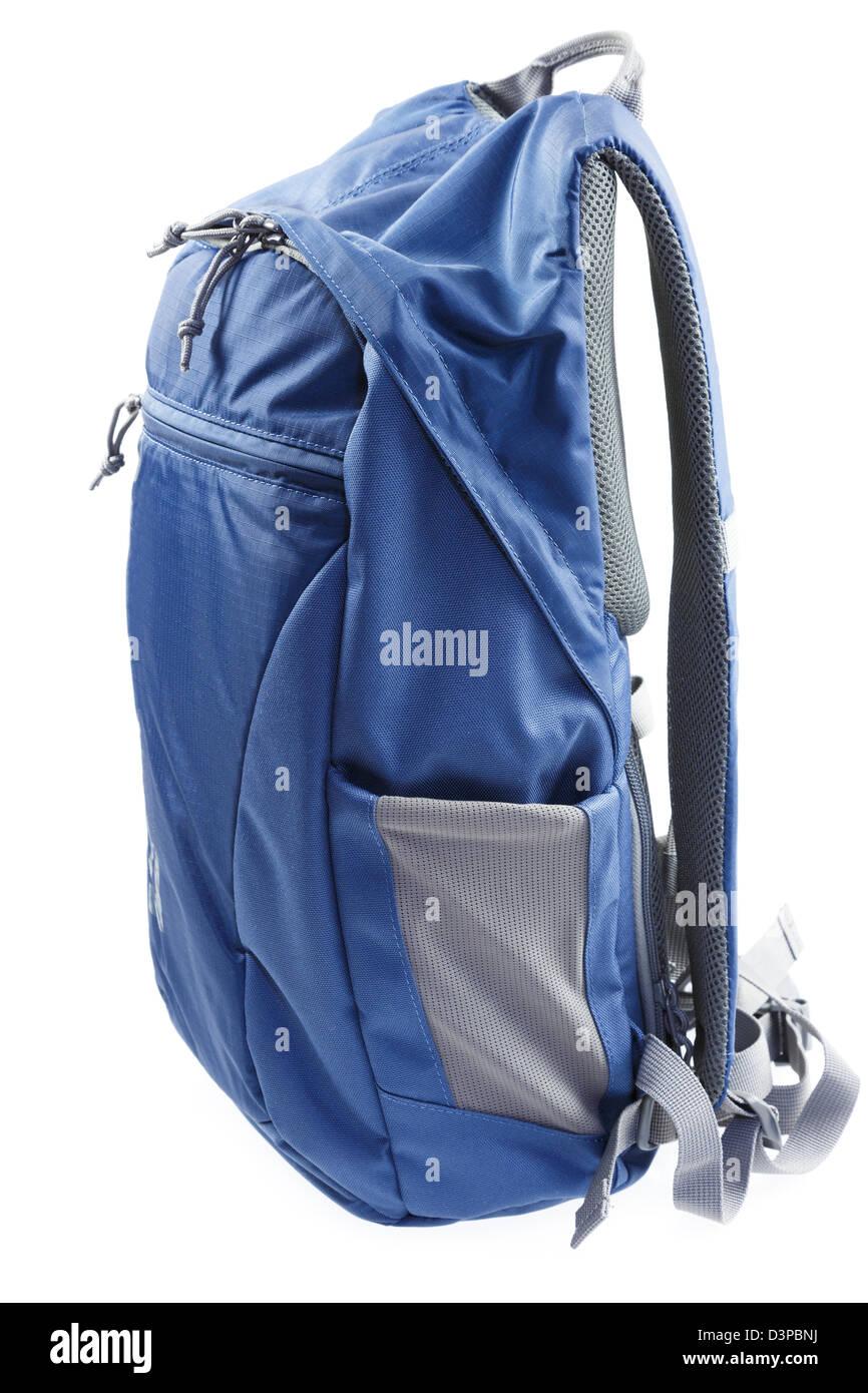 Modern blue nylon rucksack isolated on a white background. - Stock Image