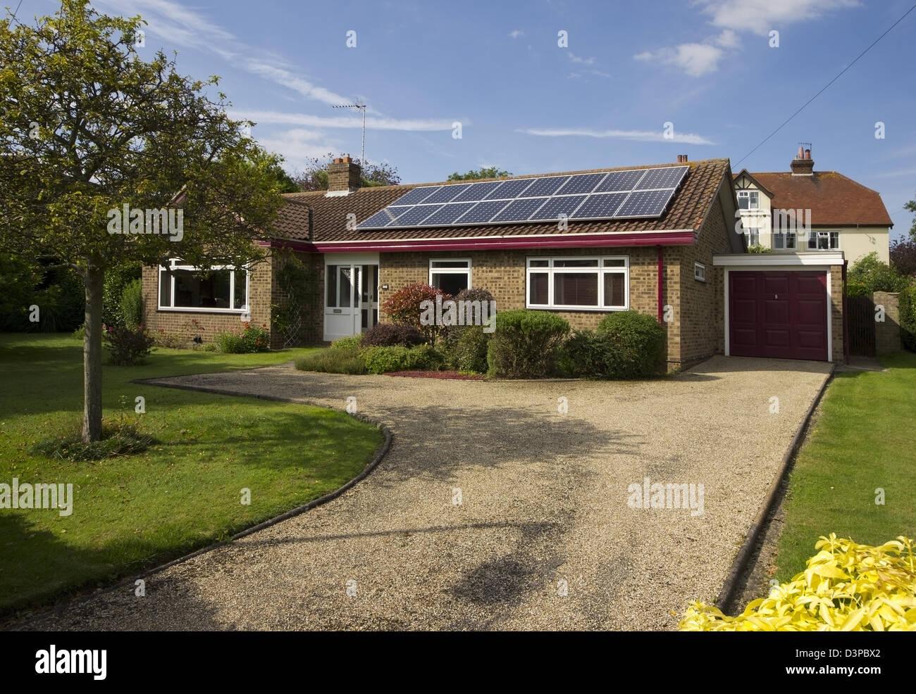 array of 16 solar panels on bungalow Stock Photo