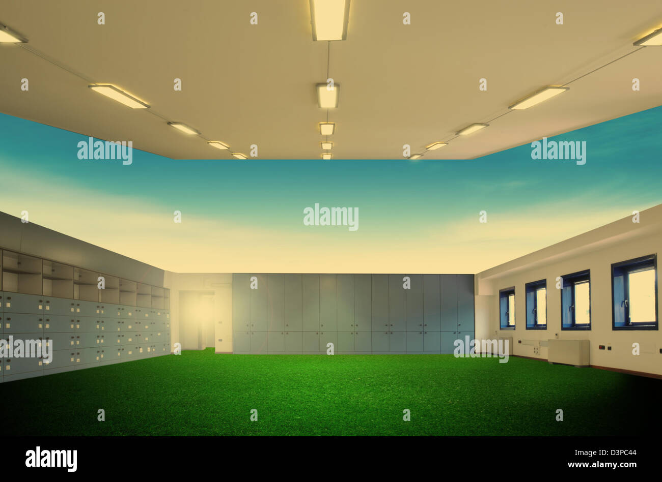 Surreal empty office with grass carpet - Stock Image