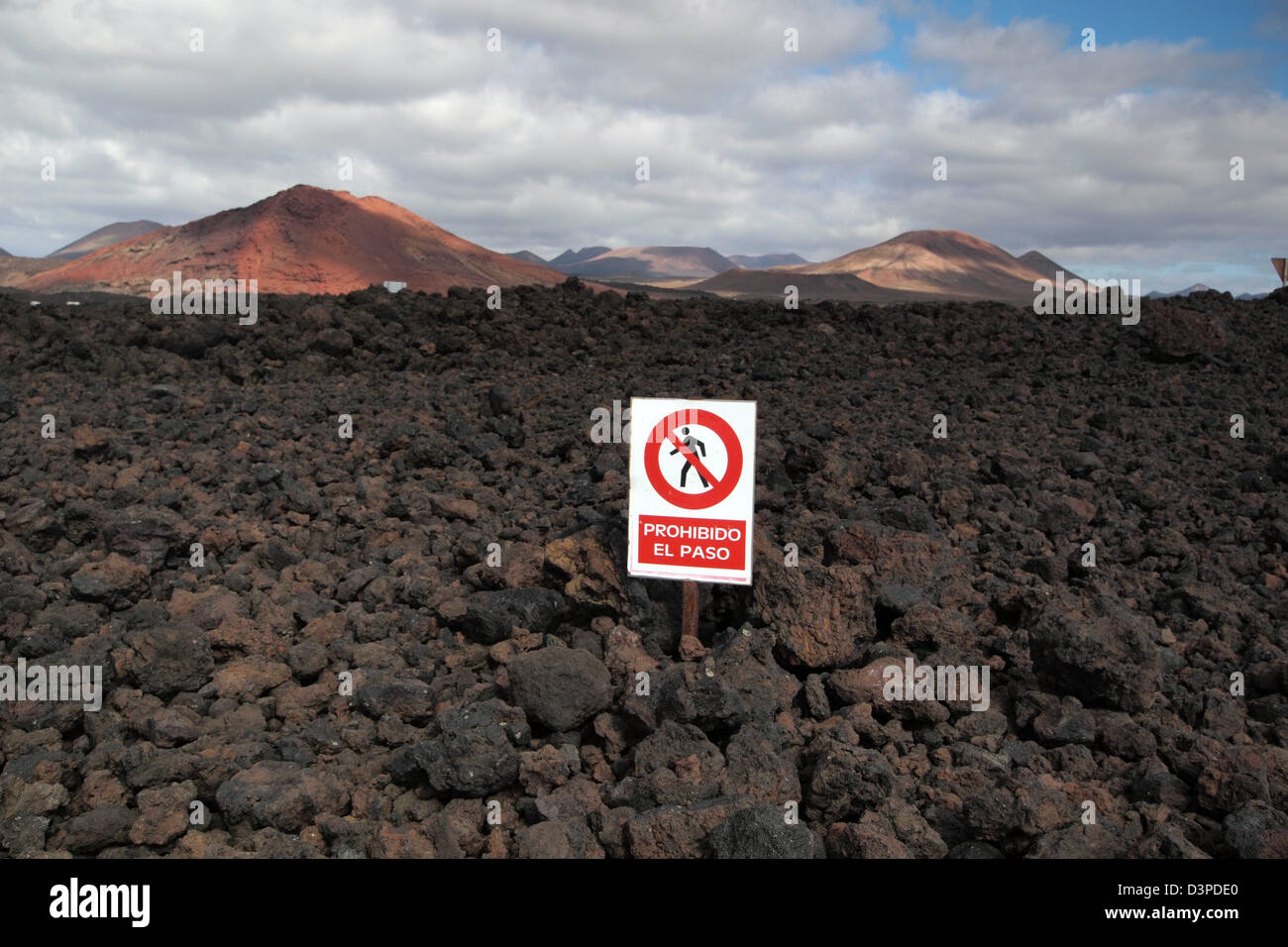 restricted access sign on lava fields in timanfaya national park, lanzarote spain canary islands - Stock Image