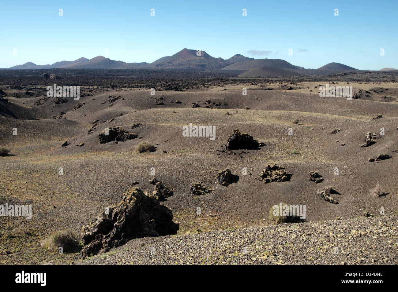 old dried lava flow fields in timanfaya, lanzarote spain - Stock Image