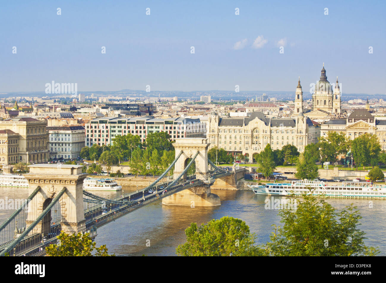 Chain Bridge over the river Danube with the Gresham hotel, St Stephen's basilica, cruise boats Budapest, Hungary, Stock Photo