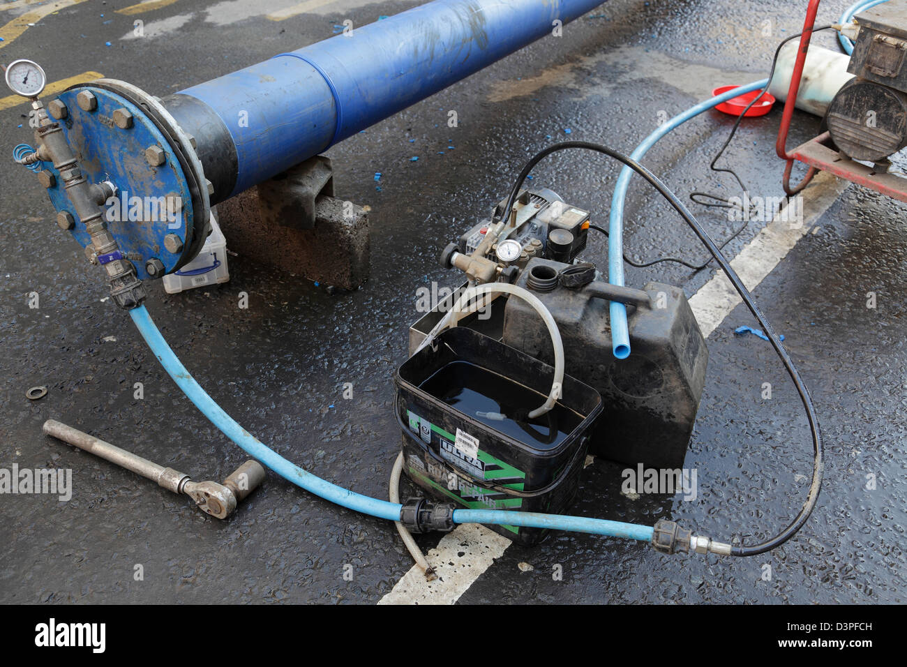 Pressure testing a pipe being installed during repairs to a water ...