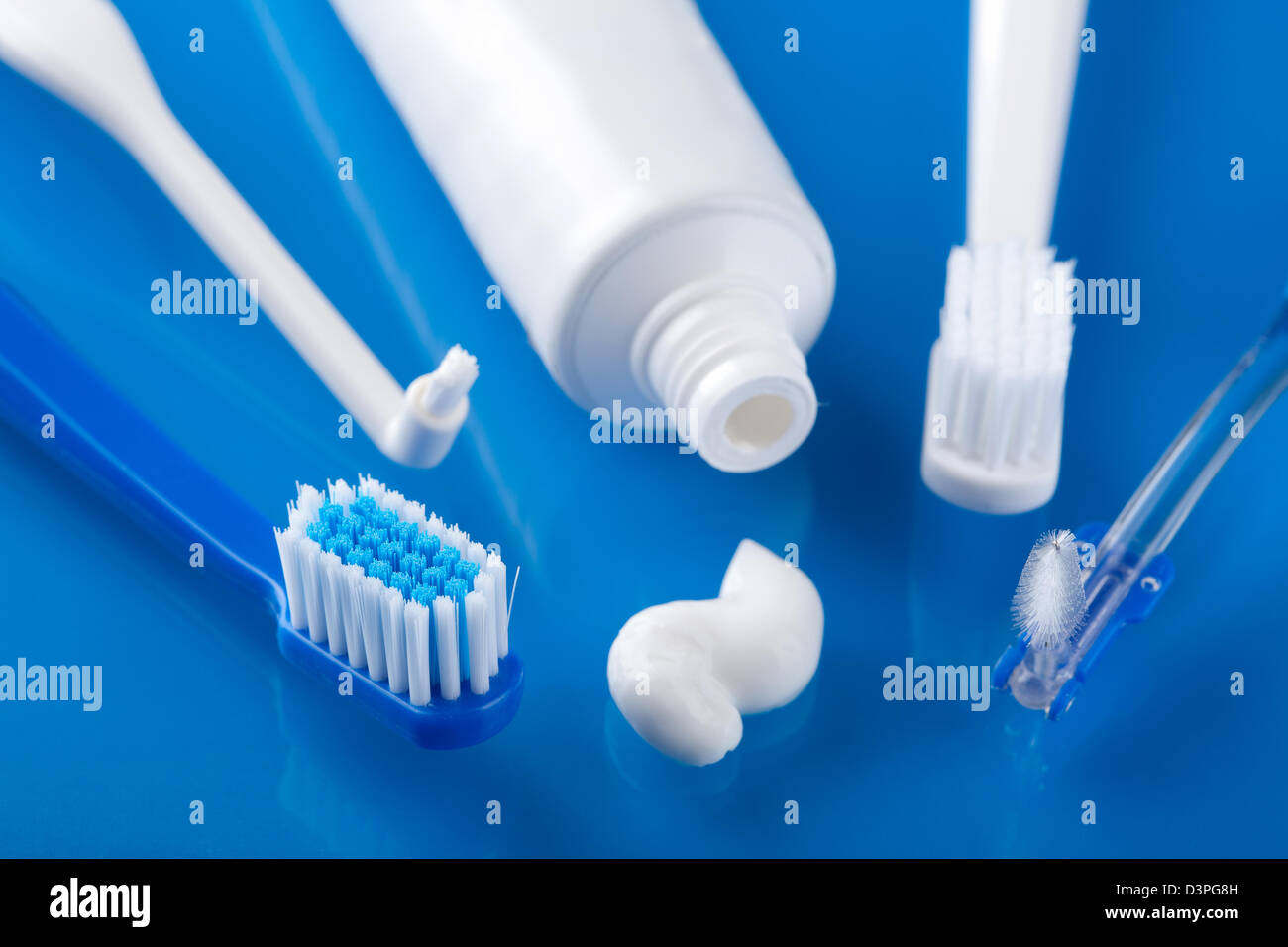 various toothbrushes and paste - Stock Image