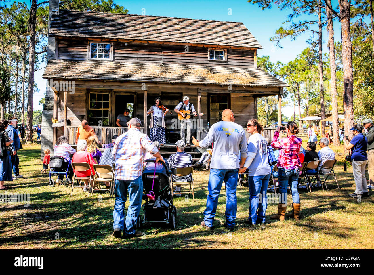 People recreating the old Pioneer spirit with music of the time at the Crowley Pioneer event in Florida - Stock Image