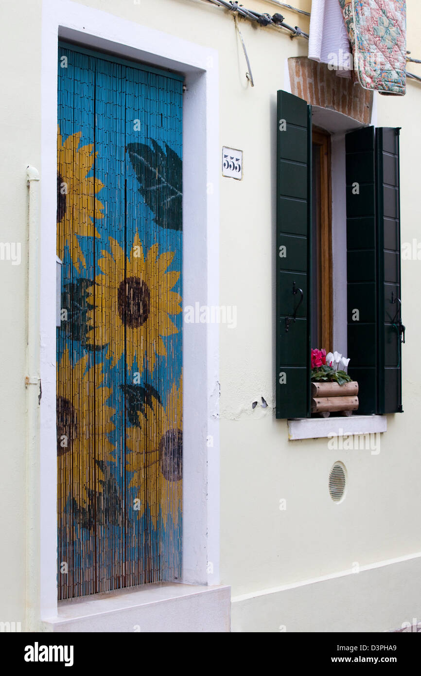 Sunflower Beaded Door Curtain on a house in Burano - Stock Image