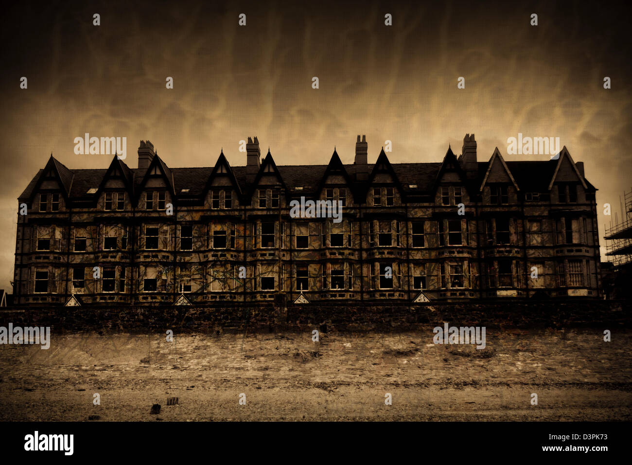 Old dark scary building in sepia - Stock Image