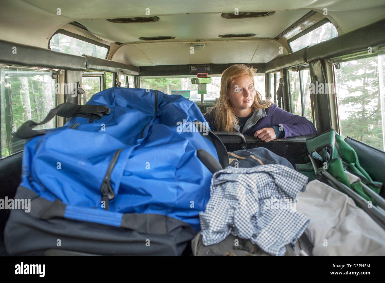 info for 533b3 83ce9 Young woman packing camping gear in classic SUV Acadia ...