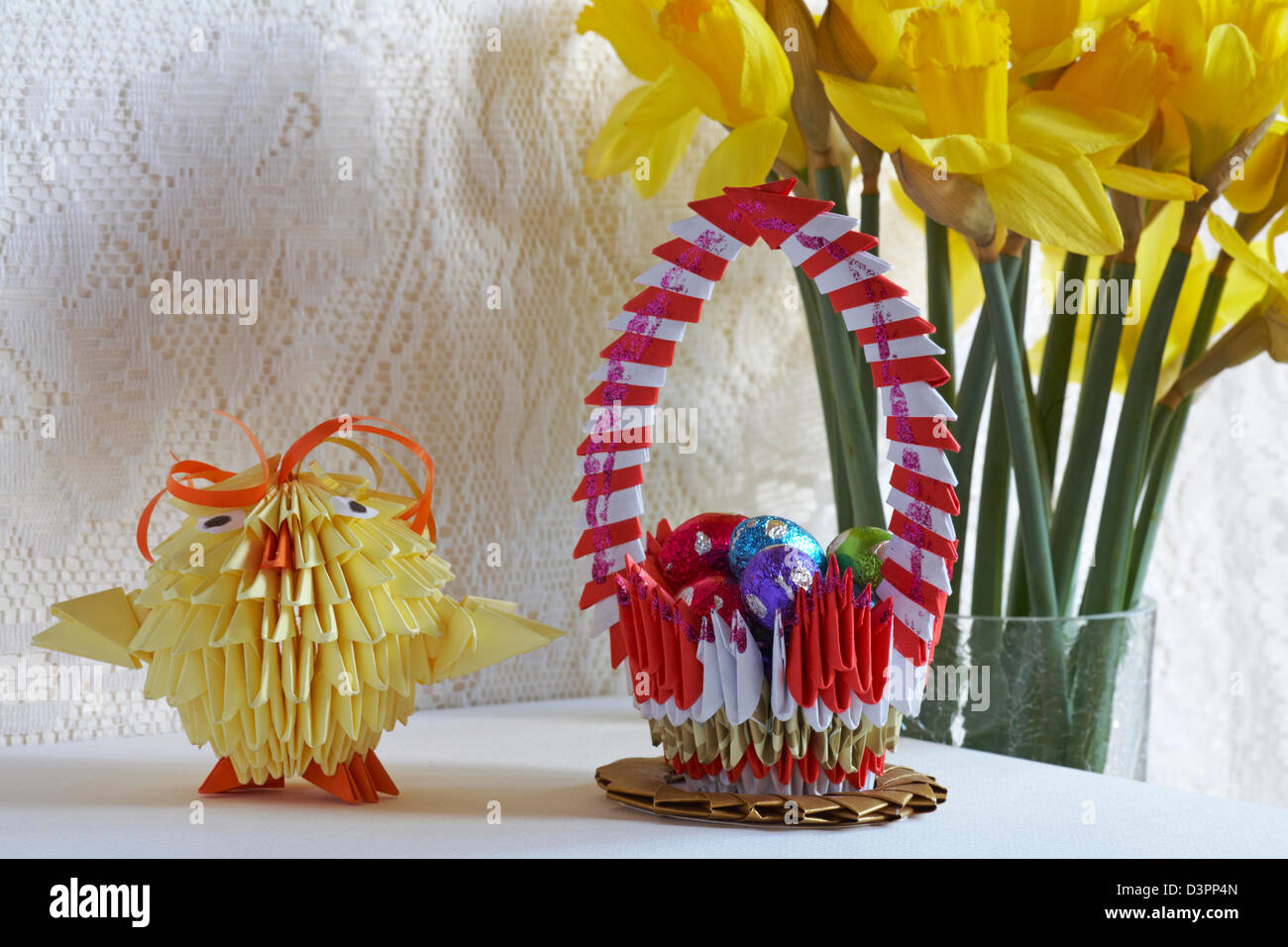Origami easter chick origami basket with mini easter eggs and stock origami easter chick origami basket with mini easter eggs and daffodils in the background mightylinksfo