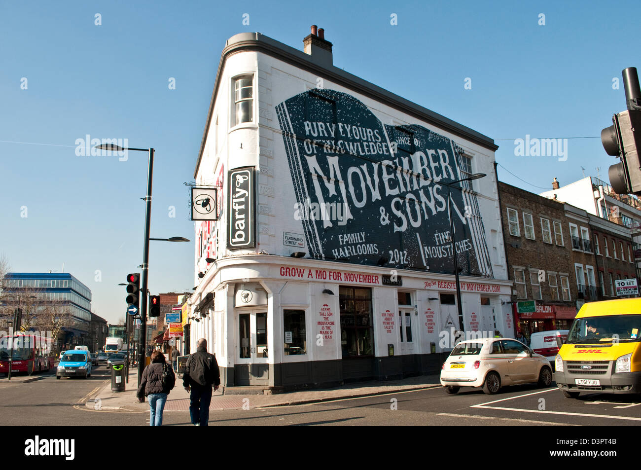 Big wall advertisement for Movember & Sons, Chalk Farm, London, UK - Stock Image
