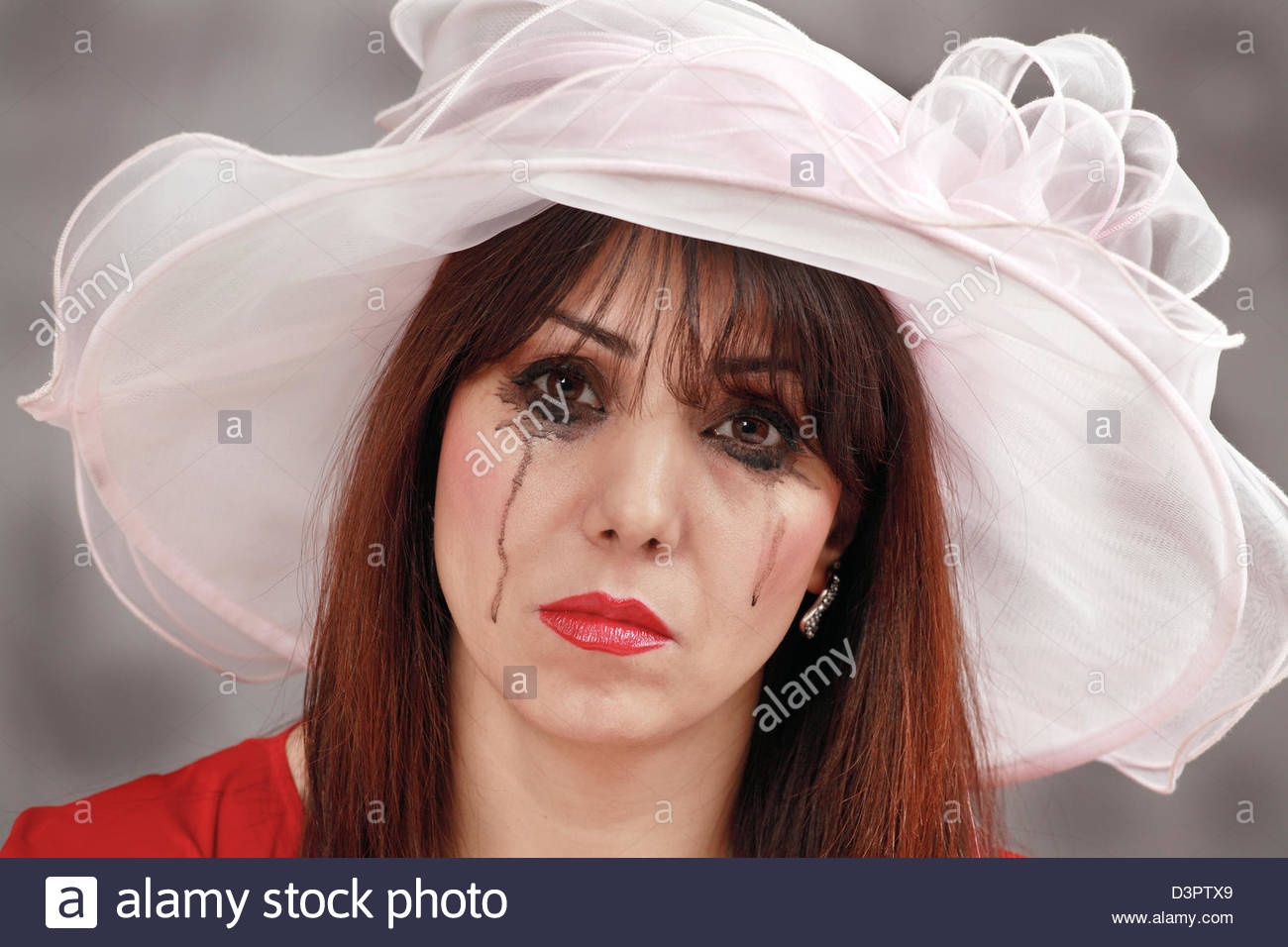 Tearful widow - Stock Image