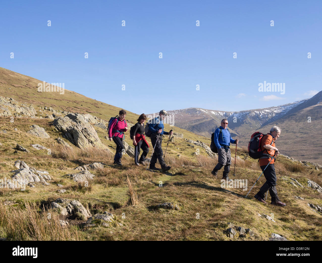 Hillwalkers descending from hills in Snowdonia National Park near Bethesda, Gwynedd, North Wales, UK, Britain - Stock Image