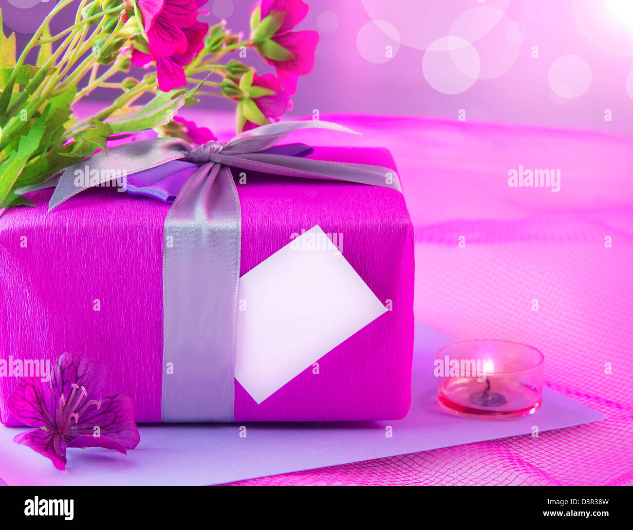 Photo of beautiful romantic still life, pink giftbox with violet ...