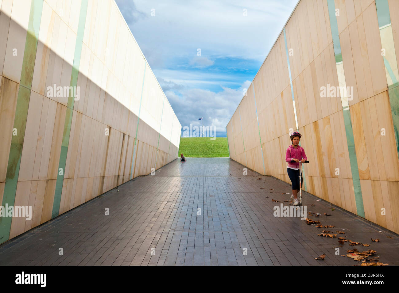 Kids playing in marble-lined walkway at Commonwealth Place. Canberra, Australian Capital Territory (ACT), Australia - Stock Image