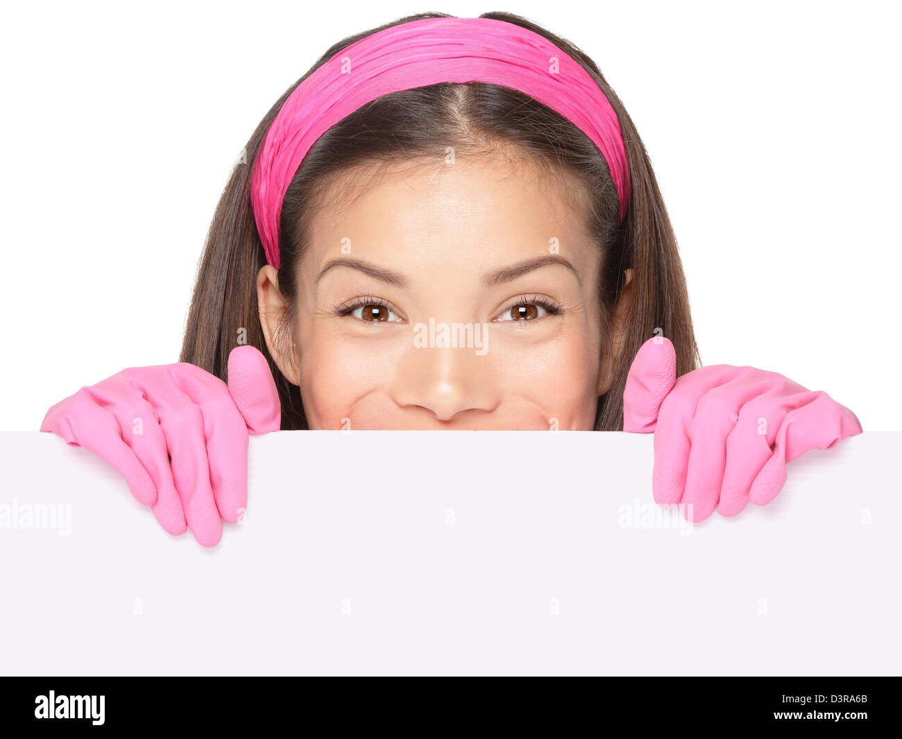 Portrait of mixed ethnicity Caucasian / Chinese Asian woman holding blank empty billboard paper sign wearing pink - Stock Image