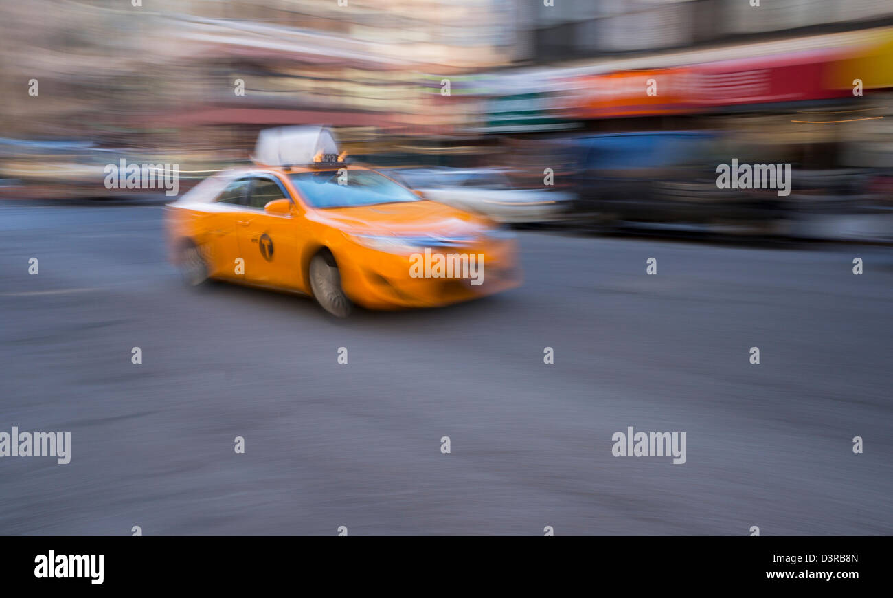 a newer hybrid model medallion yellow taxicab in New York City - Stock Image
