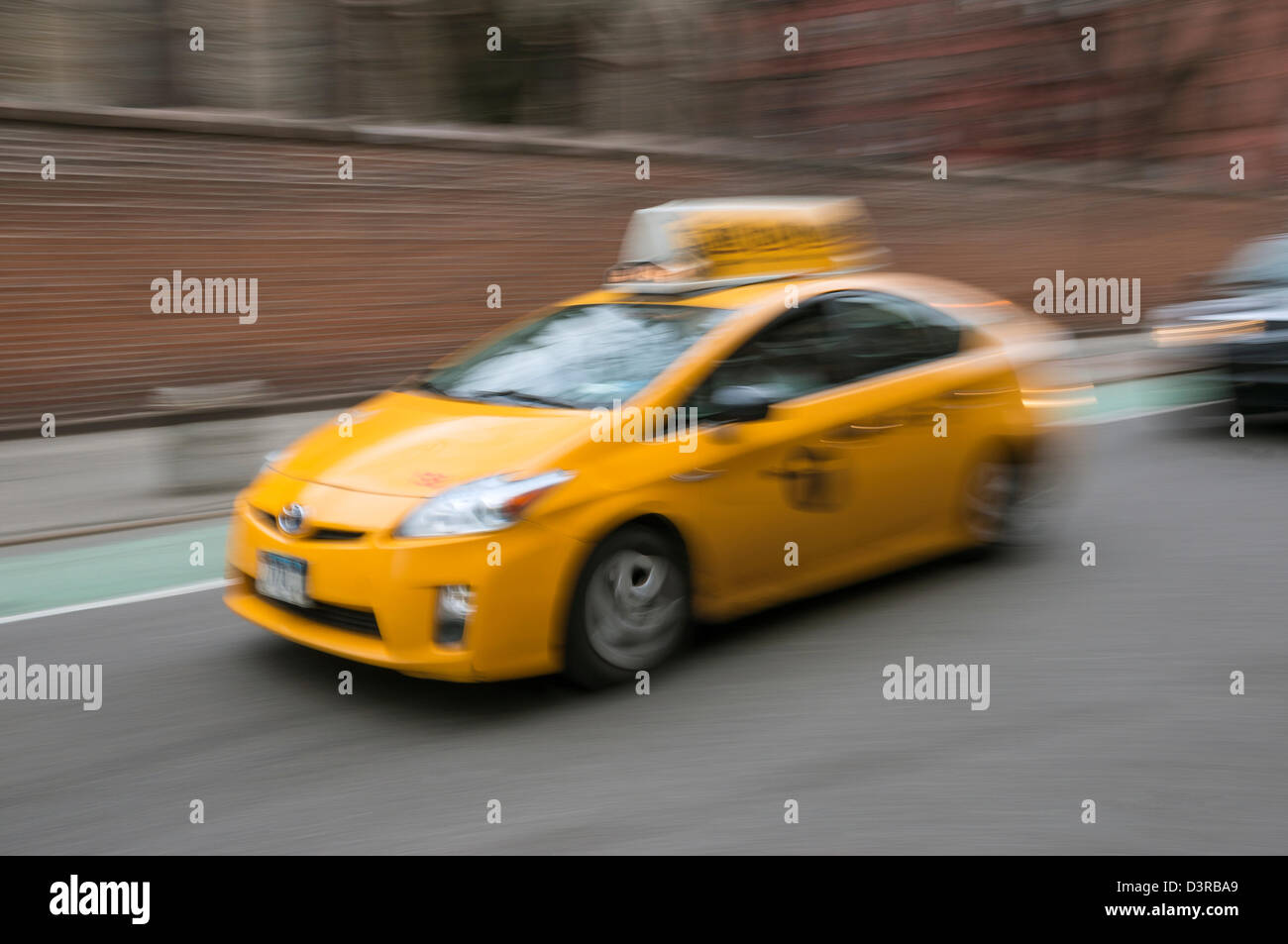 New hybrid taxi in New York City, a yellow taxicab - Stock Image
