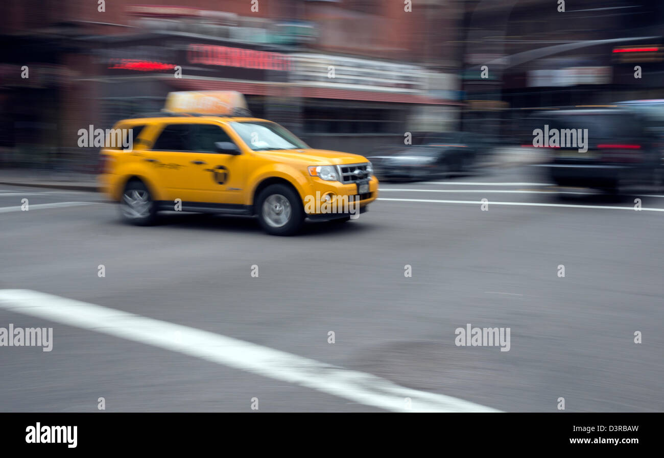 A newer hybrid model yellow taxi cab in New York City - Stock Image