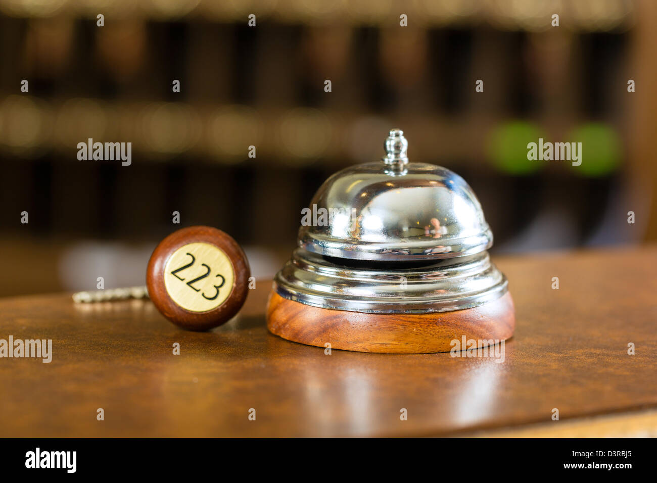 Reception - Hotel bell and key lying on the desk - Stock Image