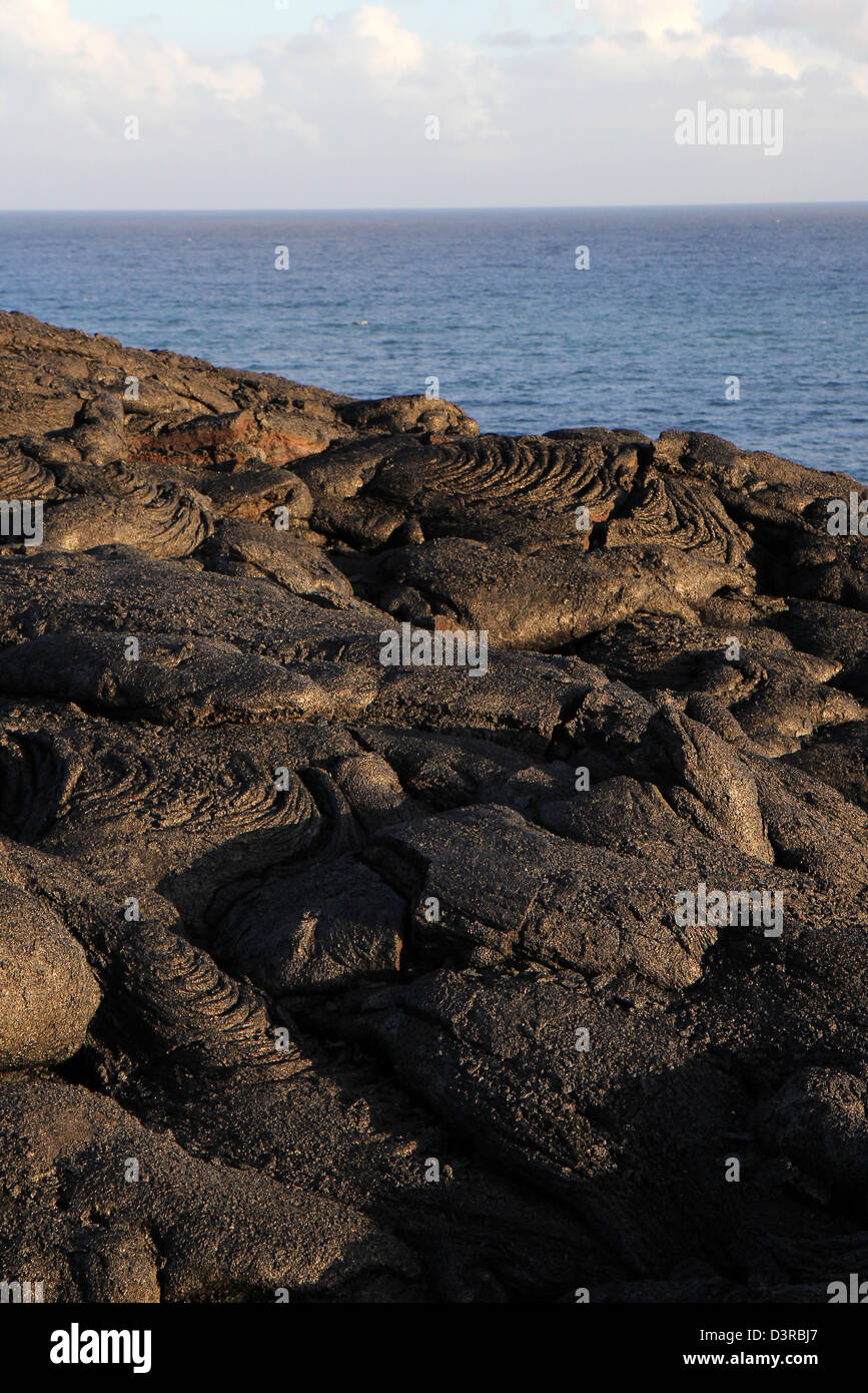 Pahoehoe lava from Kilauea Volcano near Pacific ocean Hawaii - Stock Image
