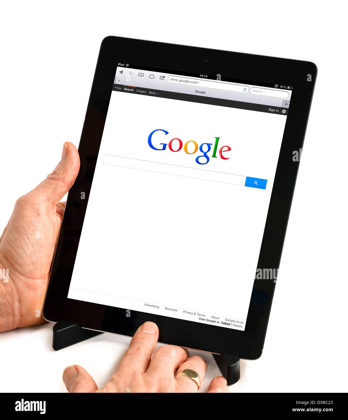 Google.com search viewed on a 4th generation iPad - Stock Image