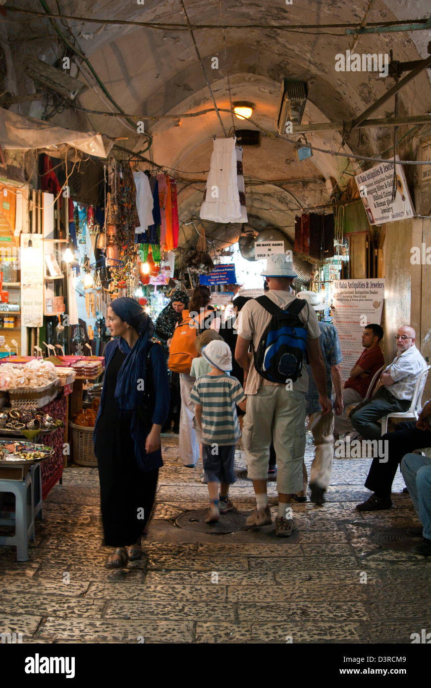 Many tourists and residents wander though the old covered streets in the Jewish quarter. - Stock Image
