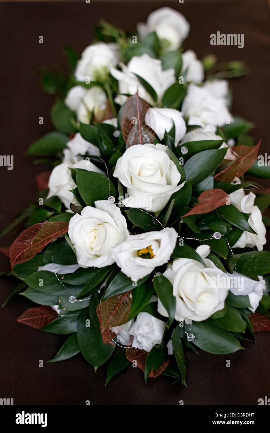 Wedding flower arrangement of vendela roses and double white stock wedding flower arrangement of vendela roses and double white lisianthus mightylinksfo