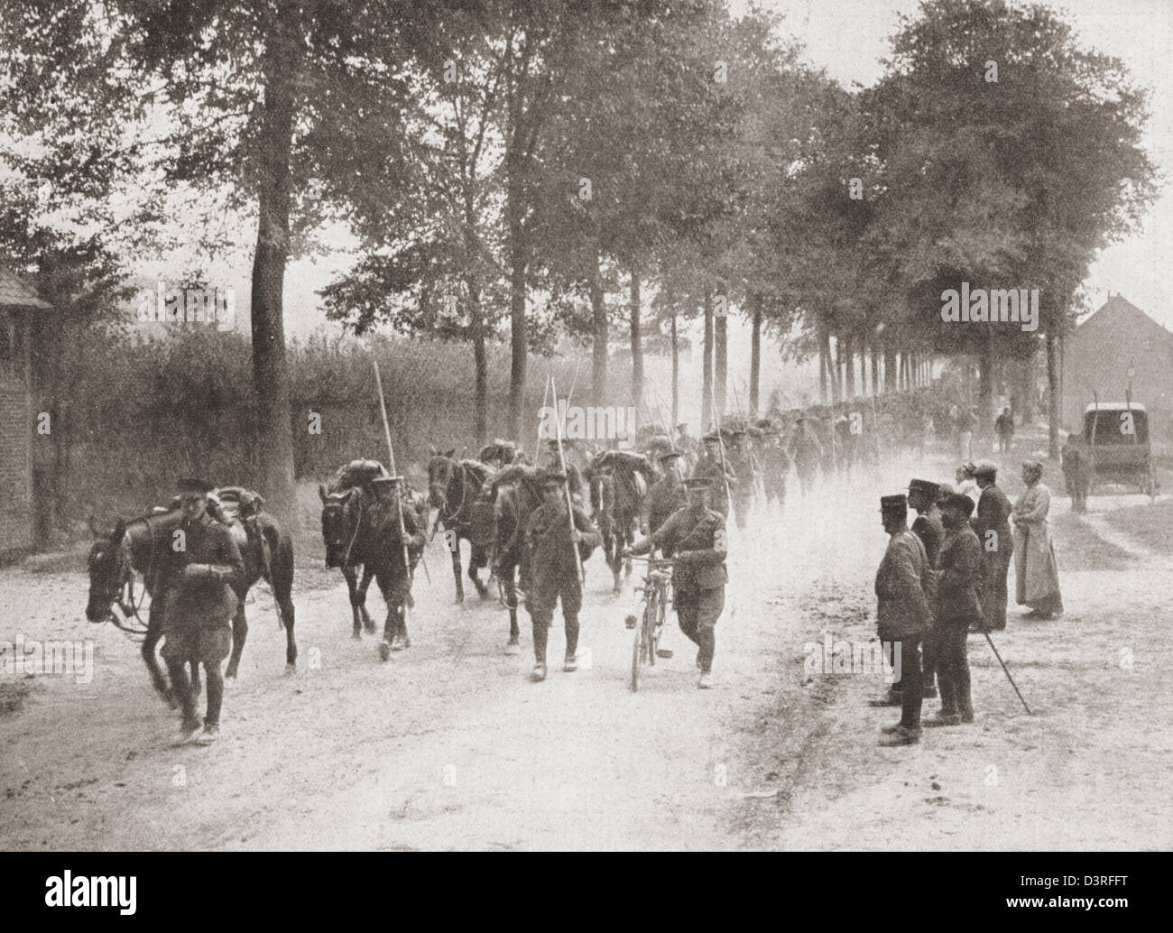 British horsemen dismount to preserve their horses in France during the First World War. - Stock Image