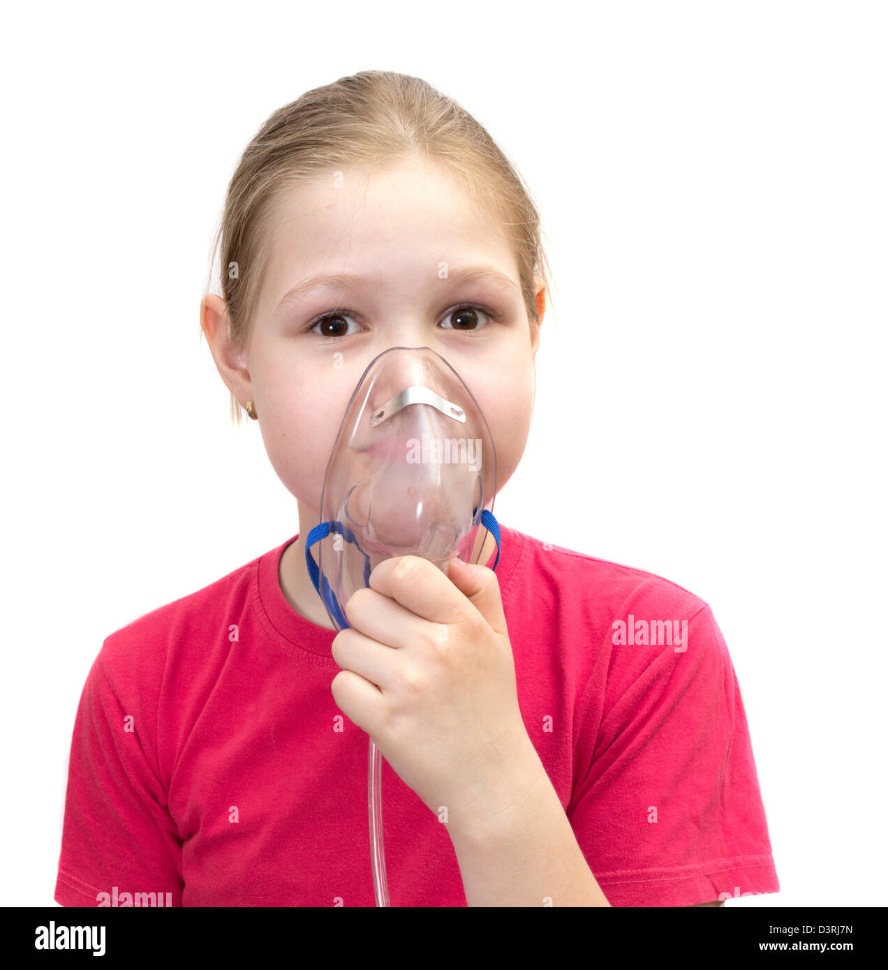 The girl with a mask for inhalations Stock Photo