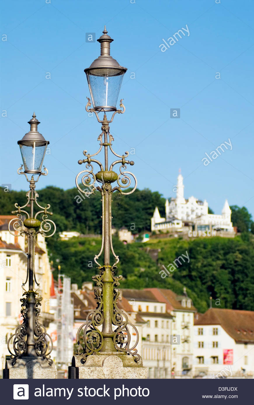 Wrought Iron Lantern At The Lucerne Old Town With The Château Guetsch In  The Background,