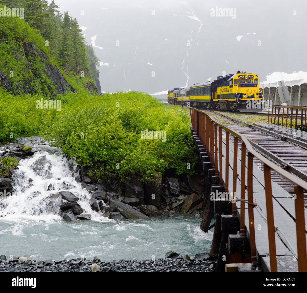 The Alaska Railroad depot and train, Whittier, Alaska, USA. A tunnel from Whittier to Portage is shared by autos - Stock Image
