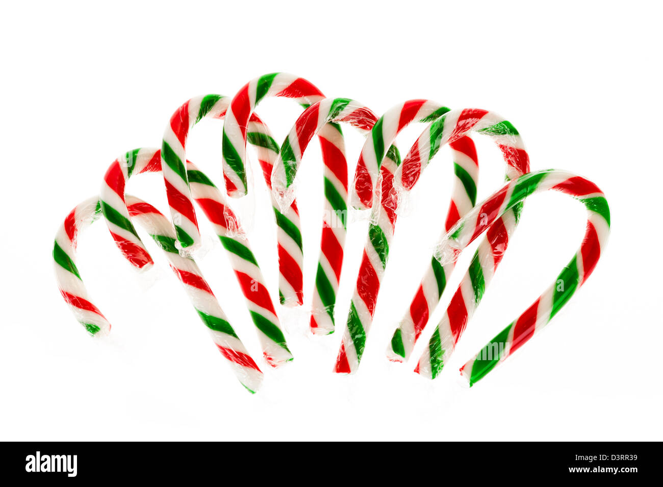 Christmas candy canes isolated on white background - Stock Image