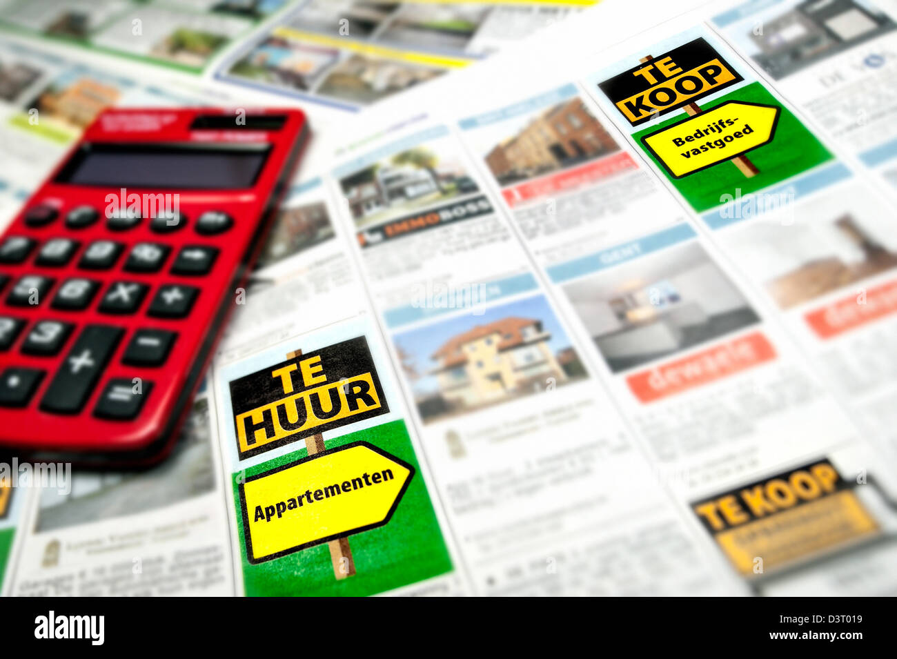Dutch advertisement columns on advertiser page showing real estate ads in Belgium - Stock Image