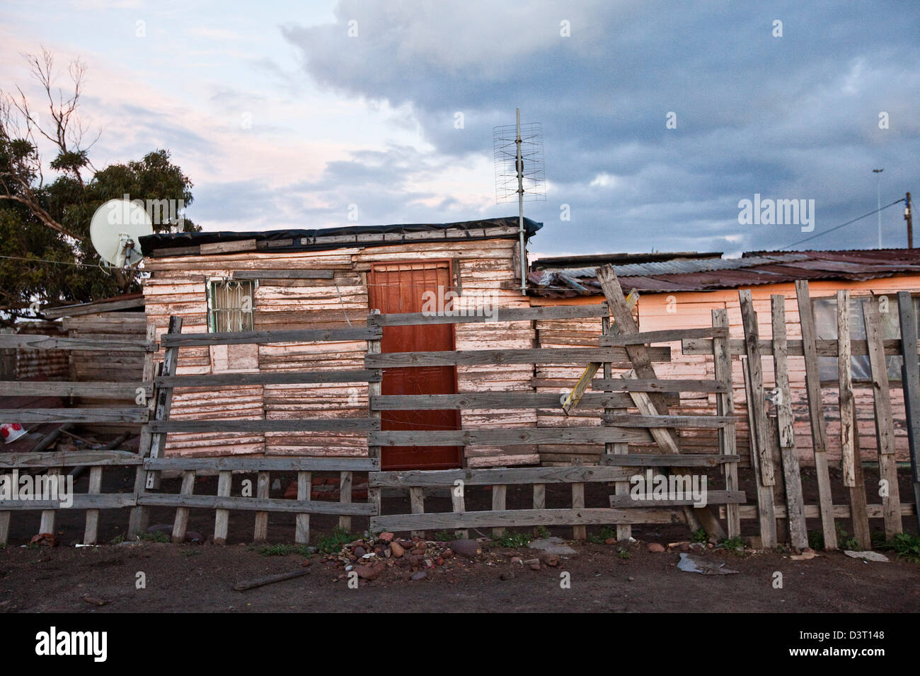 Housing exterior with fence in township, Cape Town, South Africa - Stock Image