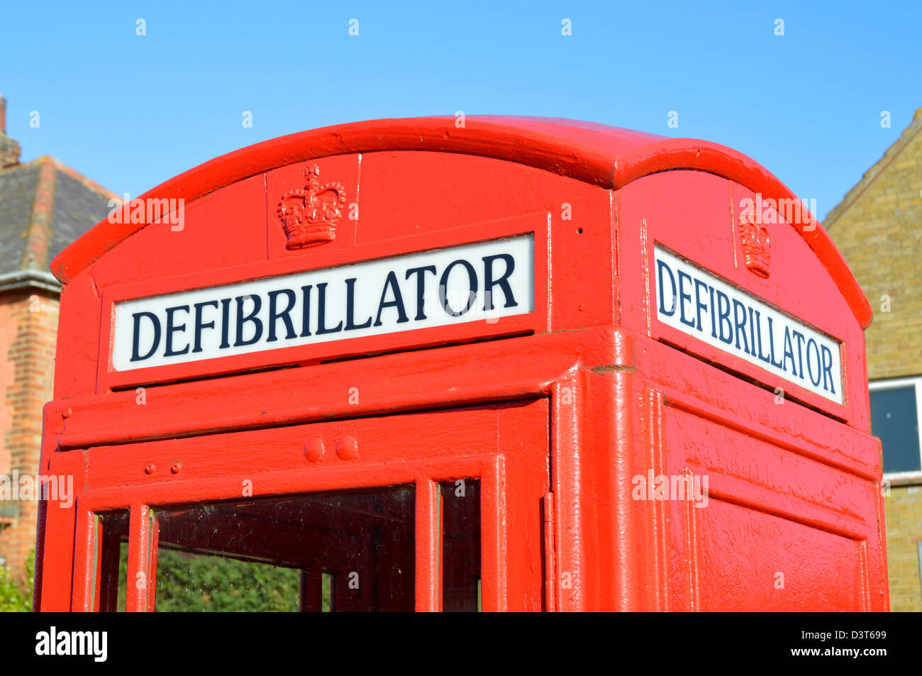 Phone box changed to defibrillator sign in red K6 telephone kiosk under the guidance of BT and Community Heartbeat - Stock Image