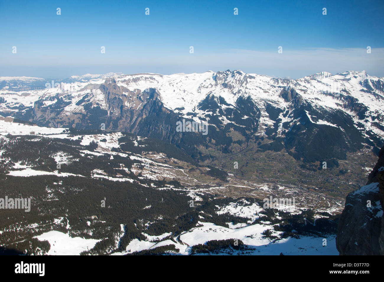 A view of snowcapped Swiss alpine mountain range seen from Eigerwand tunnel station look-out point - Stock Image