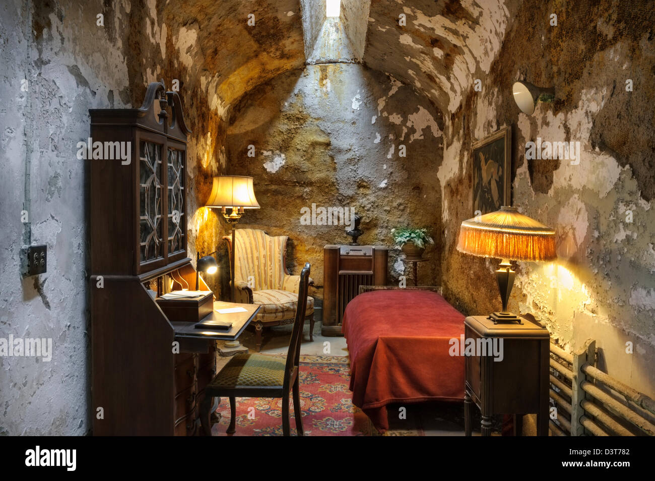 Al Capone's prison cell with furnishings during his stay at Eastern State Penitentiary, Philadelphia, PA, USA. - Stock Image
