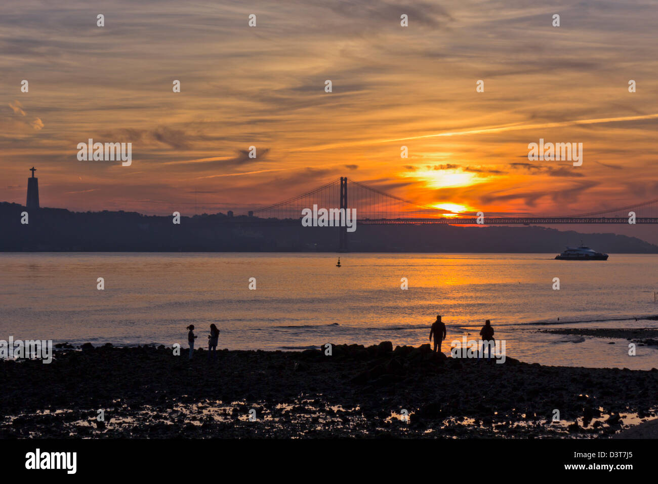 Lisbon, Portugal. View over the Tagus River towards the 25th of April bridge at sunset. Stock Photo