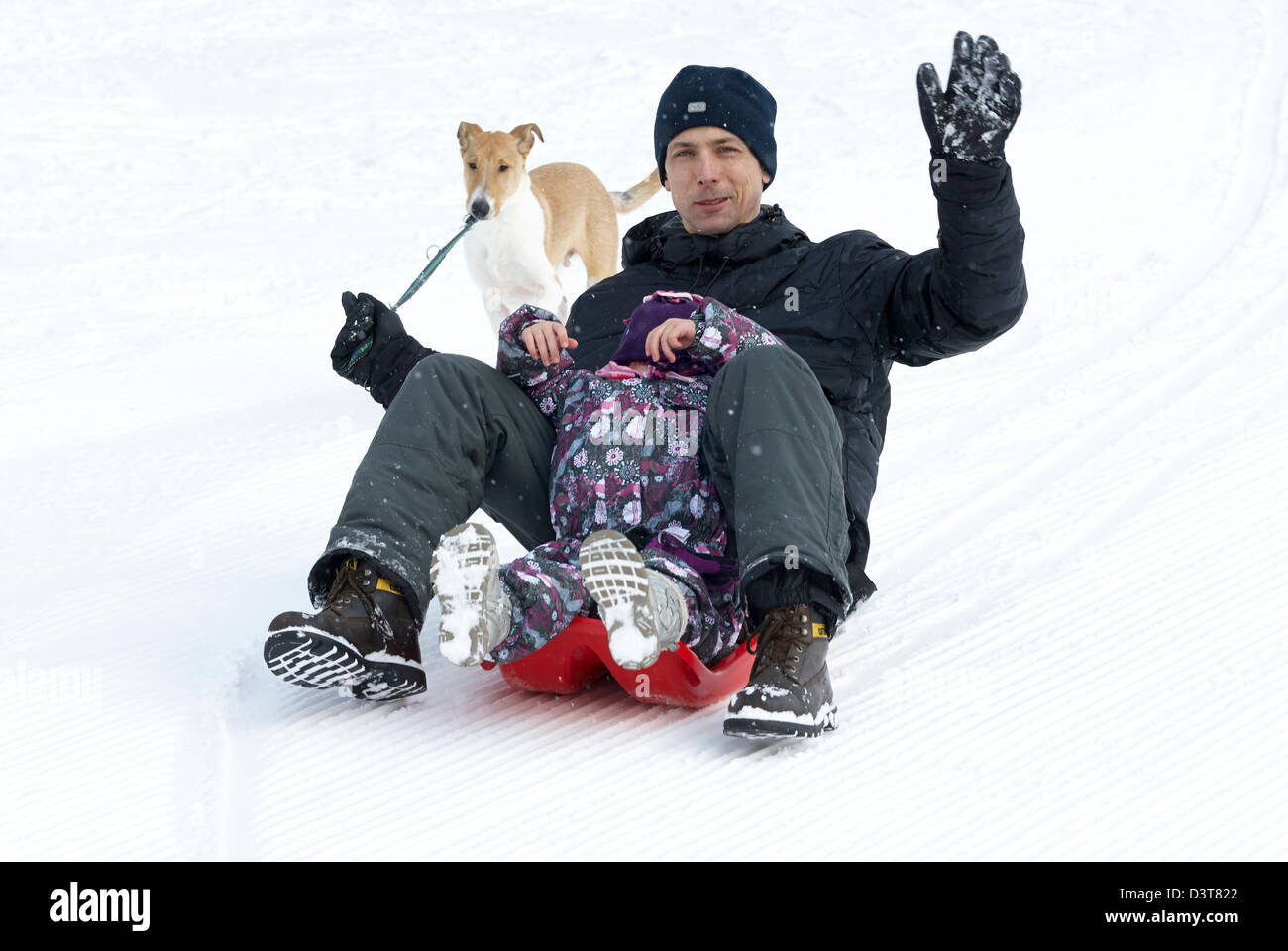 Father and daughter bobsledding winter - Stock Image