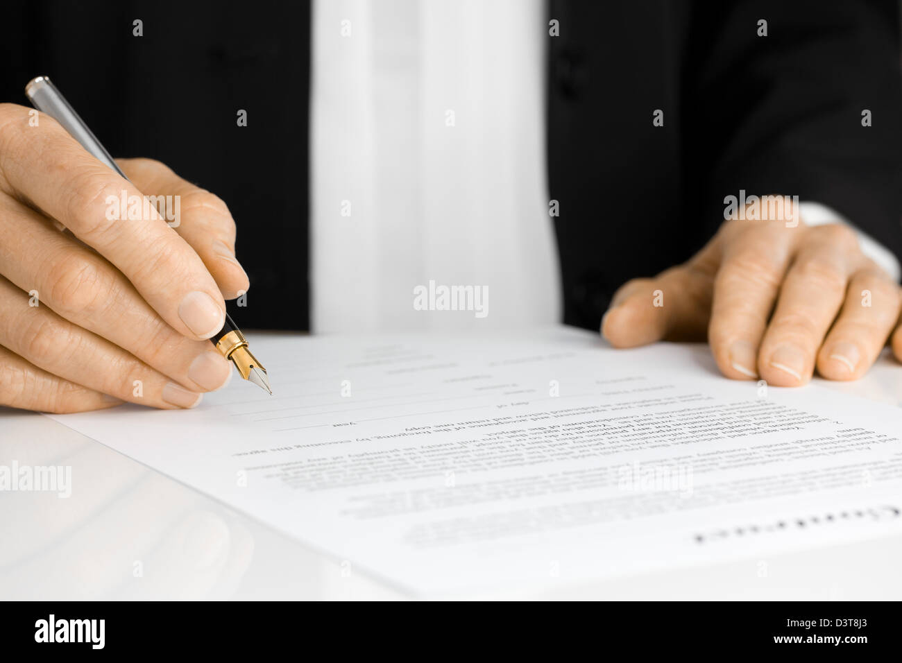 Hand Signing Contract with Fountain Pen - Stock Image