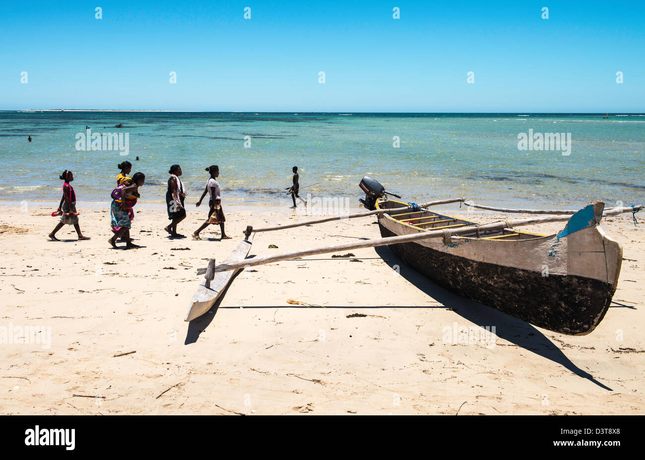 Boat and people walking on the beach Vezo fisherman village South Madagascar - Stock Image